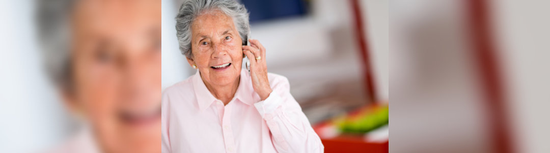 old woman calling someone using mobile phone
